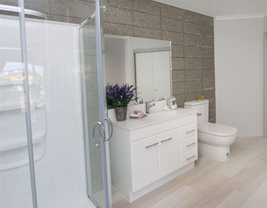 honed-concrete wall in bathroom