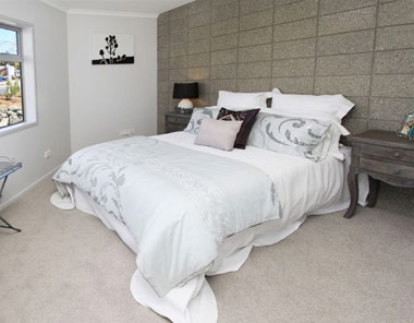 honed-concrete wall in bedroom